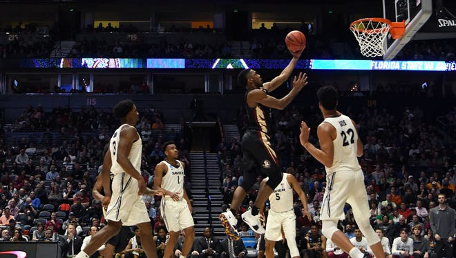 Florida State Seminoles guard Trent Forrest (3) shoots against Xavier Musketeers forward Kaiser Gates (22) during the second half in the second round of the 2018 NCAA Tournament at Bridgestone Arena.