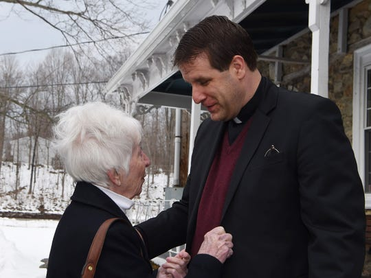 Father Robert Repenning speaks with former parishioner