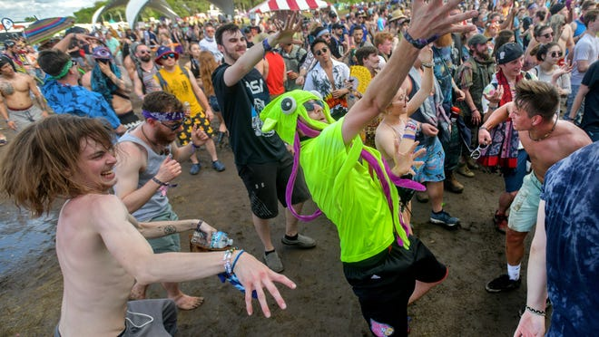 Greg Salyers, aka SQUDM4N, of Louisville, Kentucky and his crew boogie down to the electronic dance beats of Slumberjack during the Summer Camp Music Festival on Sunday, May 26, 2019 at Three Sisters Park in Chillicothe.