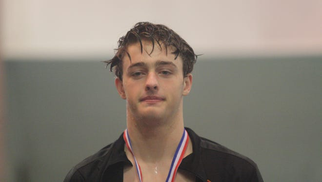 Bishop Fenwick's Adam Chaney wins the Division II state championship in the 50 freestyle on Friday, Feb. 23, 2018, at C.T. Branin Natatorium in Canton, Ohio.