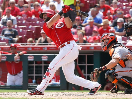 Cincinnati Reds second baseman Jose Peraza (left) hits