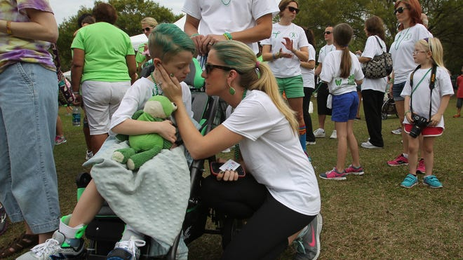 Brandi Lawrey comforts son, Gavin, after her speech about his battle with mitochondrial disease to the crowd at the United Mitochondrial Disease Foundation Inaugural Energy For Life Walkathon in Tampa.