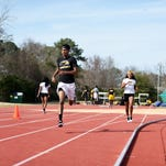 Southern Miss junior's Vallerie Norgaisse, left,  and Modesty Lorick warm up before speed work practice at the USM track and field complex on Monday.
