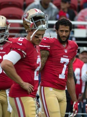 Nov. 8, 2015; Santa Clara, CA, USA; San Francisco 49ers quarterback Blaine Gabbert (2) and quarterback Colin Kaepernick (7) look on before the game against the Atlanta Falcons at Levi's Stadium.