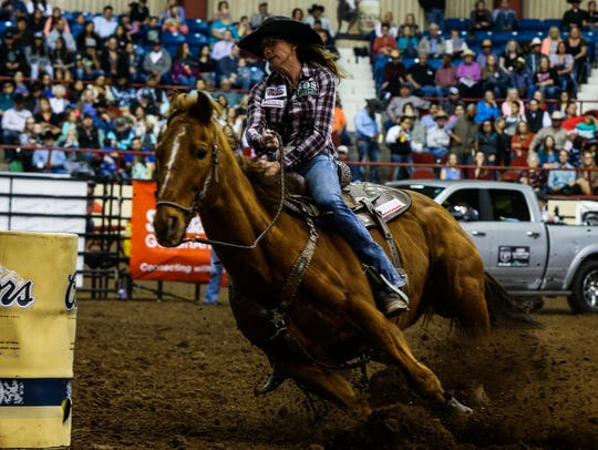 Sammy Bessert races around the first barrel during the eighth performance of the San Angelo Stock Show and Rodeo on Sunday, Feb. 12, 2017, at Foster Communications Coliseum.