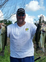 Capt. JoGene Holaway shares a couple of his Southwest Florida largemouth black bass. Holaway was fishig with artificial baits as his prime lure. The fish were released alive after the photo.