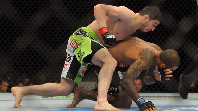 Rustam Khabilov, top, attacks  Yancy Medeiros during UFC 159 in April 2013. He called out Benson Henderson on Twitter, and Henderson chose him to fight.