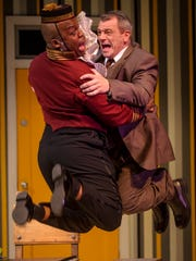 """Shawn Holmes (left) and Ray Jivoff achieve escape velocity in """"La Cage Aux Folles."""""""