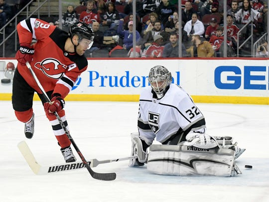 New Jersey Devils left wing Taylor Hall (9) scores a goal past Los Angeles Kings goalie Jonathan Quick (32) during the second period of an NHL hockey game Tuesday, Dec.12, 2017, in Newark, N.J.