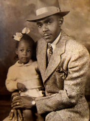 Woodie Ann Vaughns as a young child and her father.