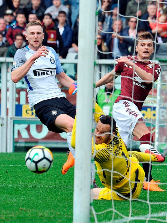 Torino's Adem Ljajic, center,  tries to score as in action with Inter Milan's Milan Skriniar, left, during a Serie A soccer match between Torino and Inter Milan at Turin's Olympic stadium, Italy, Sunday, April 8, 2018. (Alessandro Di Marco/ANSA via AP)