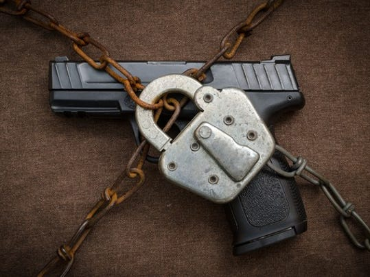 gun-control-firearm-weapon-padlock-chain-semiauto-handgun-getty_large.jpg