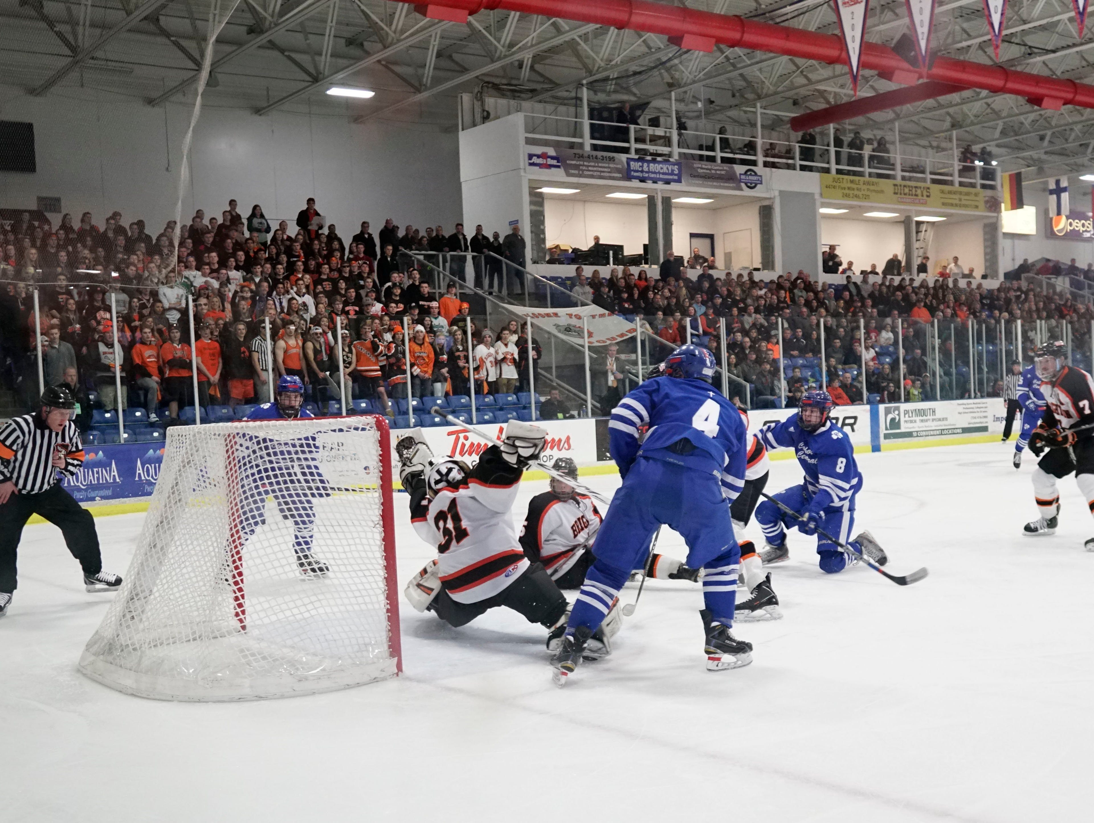 Brighton goalie Logan Neaton makes the save during Catholic Central's 3-0 win over Brighton in the 2016 Division 1 hockey final Saturday at the USA Hockey Arena in Plymouth.