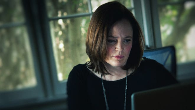 Michelle McNamara at her computer.