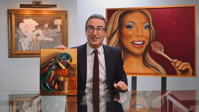 John Oliver with the three paintings he'll be sending on tour to help raise money for five museums.
