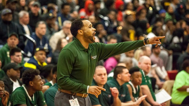 New Haven coach Tedaro France II yells to players during a quarterfinal basketball game Tuesday, March 22, 2016 at Lakeshore High School in St. Clair Shores.