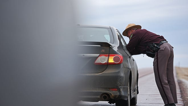 State Trooper Kristoff DeKramer, with the South Dakota Highway Patrol, speaks with a driver after pulling them over for speeding for speeding Wednesday, March 22, 2017, on Interstate 90 west of Sioux Falls.