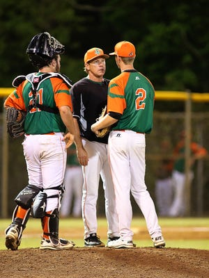 Coach Jamey Shouppe (center) consoles pitcher Kendal Weeks during a MEAC tournament game.