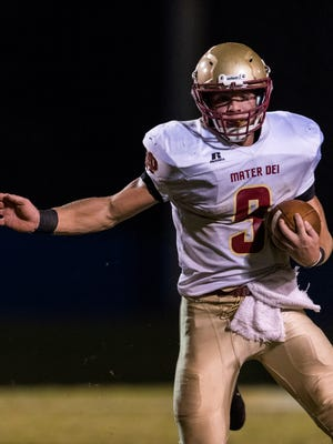 Mater Dei's Chase Rheinlander (9), shown in an earlier win over Castle, scored two touchdowns as the Wildcats routed Bosse on Friday. He gained 74 yards on 13 carries.