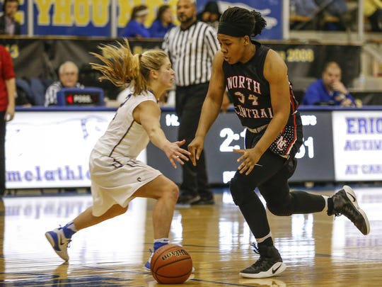 Ajanae' Thomas (34) helps lead the way for unbeaten and top-ranked North Central.