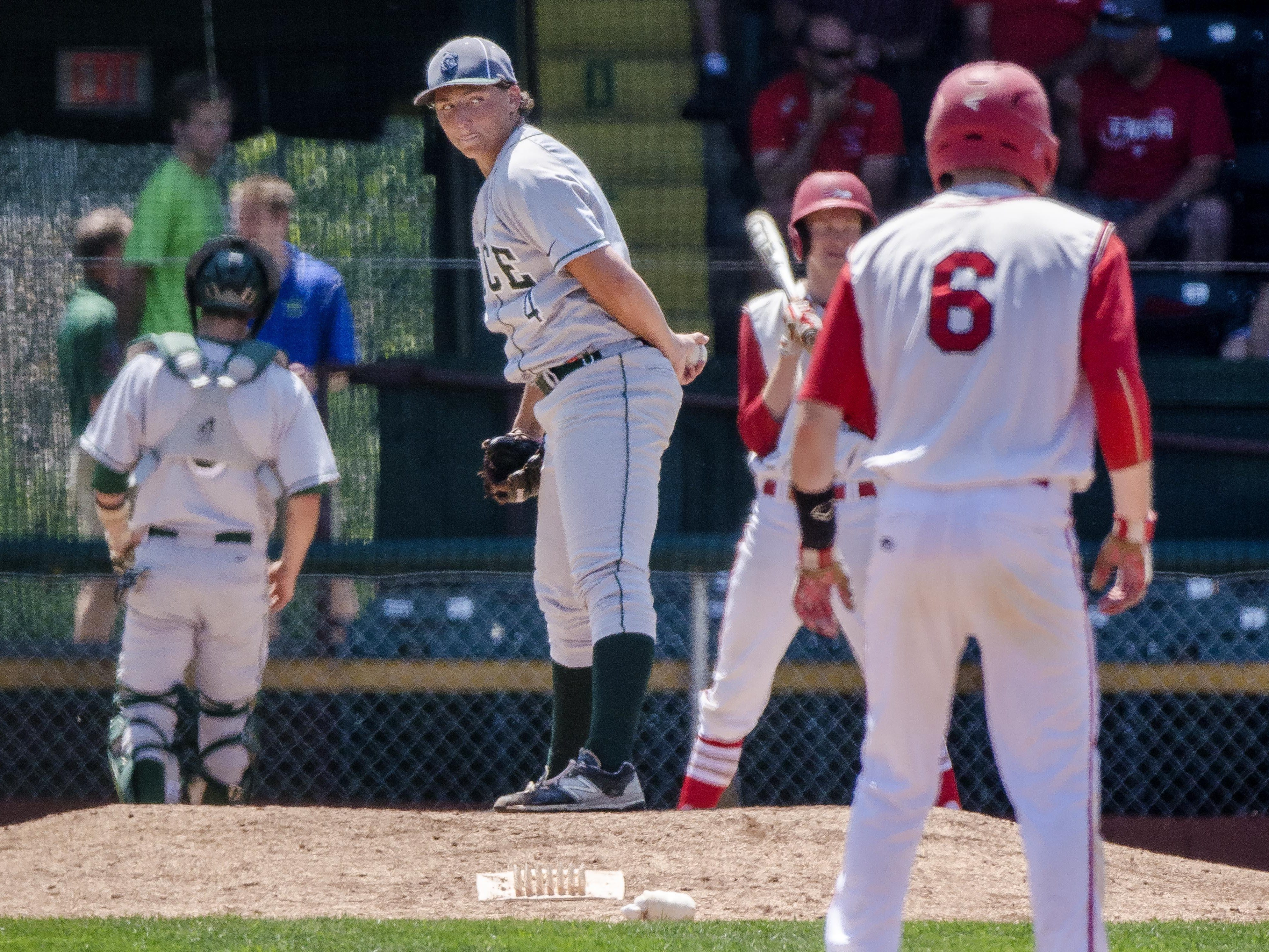 Rice's William Hesslink keeps an eye on the bases against CVU during the Division I state high school baseball championship at Centennial Field in Burlington on Saturday, June 13, 2015.