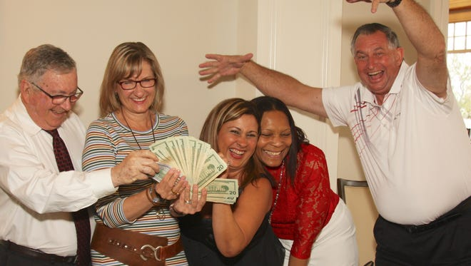 Gregg Wyatt, 50/50 winner Sara Rittersbach, Fashion Show Co-chairs Diana Gonzalez and Angela Hayle, and John Gallagher celebrate. Rittersbach, a former member of Port St. Lucie Business Women, generously donated $1,000 of her winnings back to the organization to go toward funding an additional scholarship.
