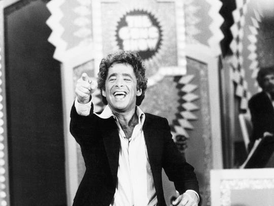 Chuck Barris, the maniacal host-producer of 'The Gong Show' and producer of '$1.98 Beauty Show' reacts during a taping session of one of his Gong shows. Barris wrote, produced, directed and starred in 'The Gong Show Movie,' based on the TV series.  It included a bunch of his weirdest contestants, ones whose acts are too bizarre for TV. (Copyright Bettmann/Corbis / AP Images)