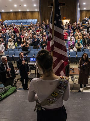 A color guard from Girl Scout Troop 30755 presents the American flag for the Pledge of Allegiance before the start of the Essex town meeting Monday night, March 6, 2017, at the high school.