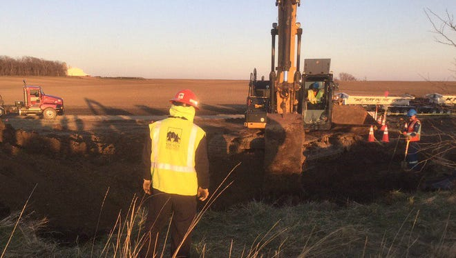 A TransCanada crew works on the investigation of an oil leak near Freeman.