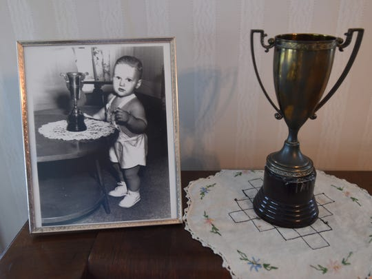 A photo of Bill Clinton and the trophy he won for prettiest