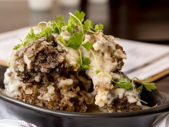 Tempura-battered Maitake mushrooms with truffled fontina fondue at Braun's Tavern in Bloomfield on Friday July 27, 2018.
