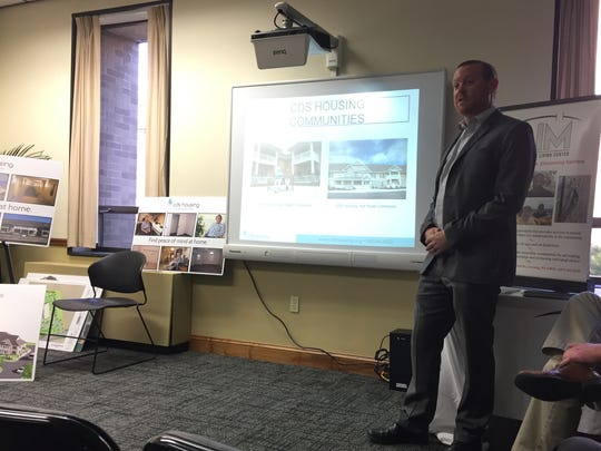 Justin Mirando of CDS Life Transitions discusses a proposed senior housing complex in Elmira Nov. 28 at AIM Independent Living Center's offices.