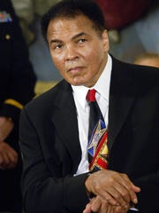 Three-time heavyweight boxing champion Muhammad Ali attends the presentation ceremony for the Presidential Medal of Freedom in the East Room of the White House 09 November 2005 in Washington, DC.