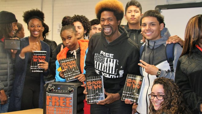 Dr. Amir Whitaker and students from Barack Obama Academy for the Academic & Civic Development.