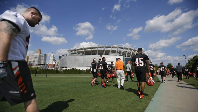 Players walk off the field after the first day of Bengals rookie mini-camp. Only five tryout players earned contracts.