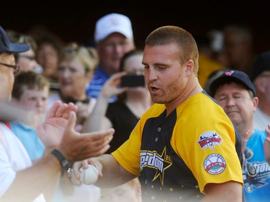 Green Bay Packers fullback John Kuhn, originally from Dover, hands a fan the ball he threw out for the first pitch before the start of the 2011 Atlantic League All-Star game.
