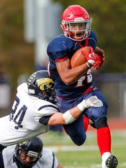 Chenango Forks' Jeremiah Allen shakes a tackle attempt by Susquehanna Valley's Joshua Rudock.