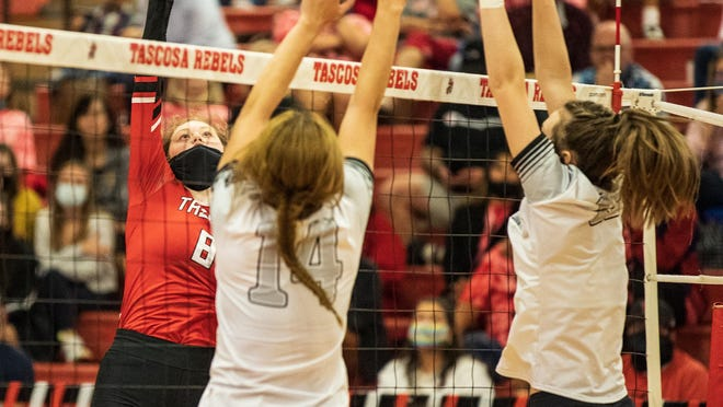 Tascosa's Liv Sims (8) tries to hit the ball between Randall's Julia Woolsey (14) and Delanie Patterson in Saturday's District 3-5A volleyball opener. Tascosa won in five sets.