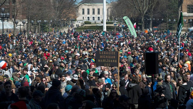 "A crowd gathers during Hash Bash on Saturday, April 1, 2017 at the University of Michigan in Ann Arbor. The event brought supporters of marijuana together with shouts of ""Free the weed!"""