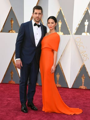 Aaron Rodgers, left, and Olivia Munn arrive at the Oscars on Sunday, Feb. 28, 2016, at the Dolby Theatre in Los Angeles. (Photo by Jordan Strauss/Invision/AP)