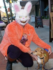 Teresa Patton dressed as a scary rabbit poses with her dog Kenny Rascal.
