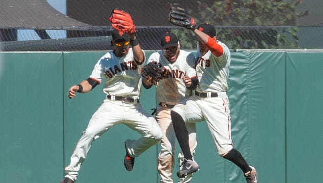 Giants outfielders Angel Pagan, Gregor Blanco and Hunter Pence celebrate after defeating the Nationals at AT&T Park.