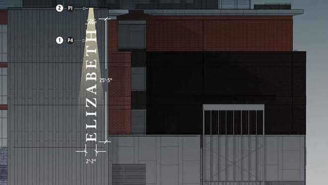 The sign for The Elizabeth hotel under construction in downtown Fort Collins, will be 25 feet high, three times larger than code allows. Developers got special permission from the city's zoning board to erect the tall sign.