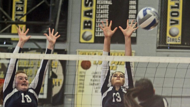 Pelham's Alana Pettus, left, and Kailee Chimento try to block a shot by Nanuet's Laura Zazyczny during a varsity volleyball match at Nanuet High School Sept. 24, 2015. Pelham defeated Nanuet in three games, 25-18, 25-13, and 25-13.