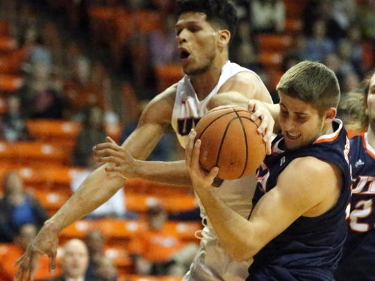 UTEP's Paul Thomas could not get to the rebound before Byron Frohnen, 3, of UTSA Saturday night.
