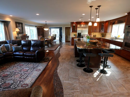 A spacious, remodeled kitchen and living room in this