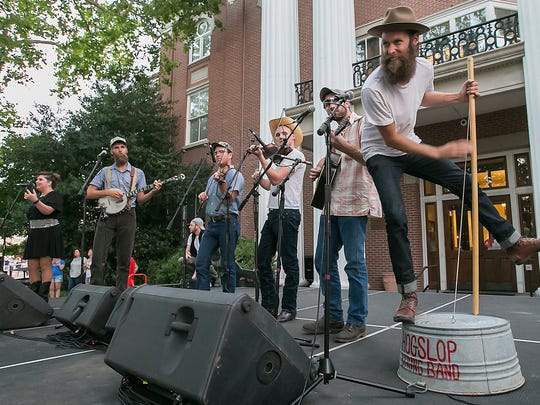 The Hogslop String Band provides music for the dancers at the Public Square in Murfreesboro in an attempt to break the world square dance record.