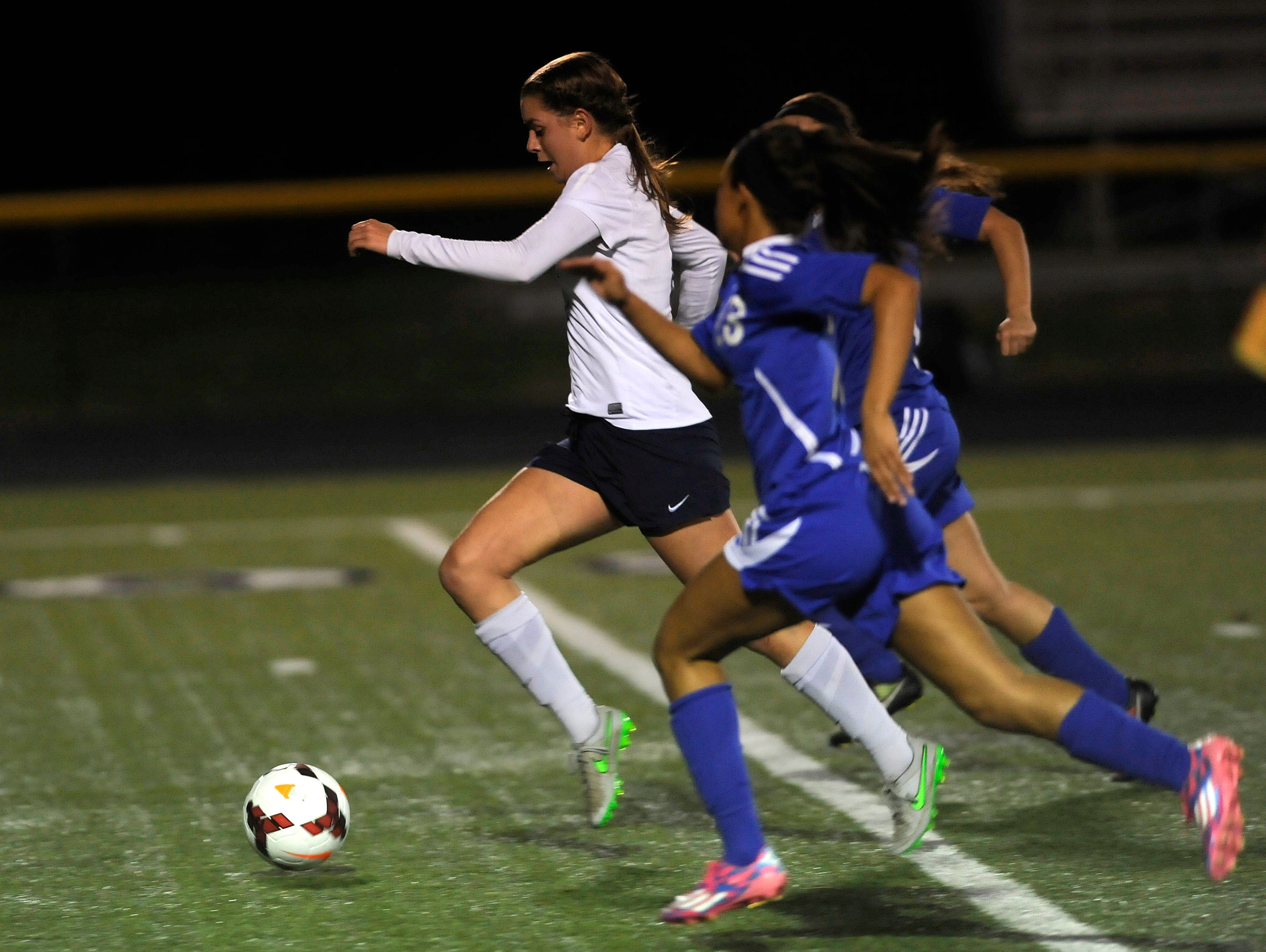 Granville's Rose Sawyers breaks away from Chillicothe defenders to score her third goal during Tuesday night's Division II regional semifinal game at Bloom-Carroll. The Blue Aces defeated Chillicothe 8-0.
