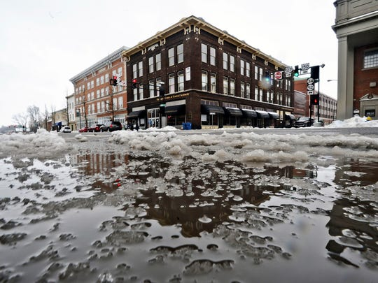 Main Street is flooded Saturday, Feb. 21, 2015., in