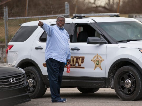 Jerome Johnson (left), an assistant pastor at First Baptist Church North, Indianapolis, gives directions to D.J. Nuetzmann, a Sheriff's Deputy from Martinsville, after a visit to the Indianapolis church, Thursday, February 23, 2017.